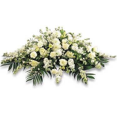 Cojín fúnebre con flores surtidas de la temporada.