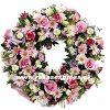 Corona fúnebre con flores surtidas de la temporada para Regiones
